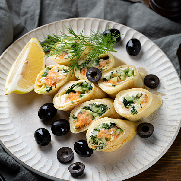 Pancakes with salmon, cucumber and cheese