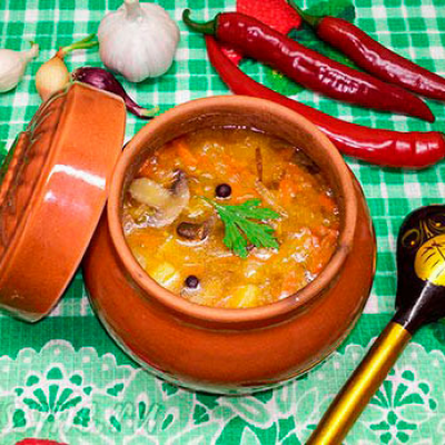 Mushroom soup with lentils in a pot