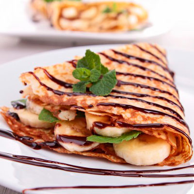 Pancakes with banana and chocolate topping
