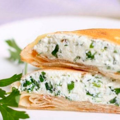 Salted pancakes with cottage cheese and dill
