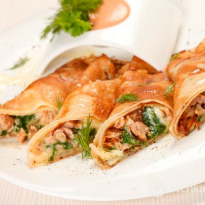 Pancakes with chicken and mushrooms